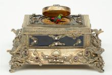 An exceptional gilt silver music box, partially cobalt blue enamelled, ruby