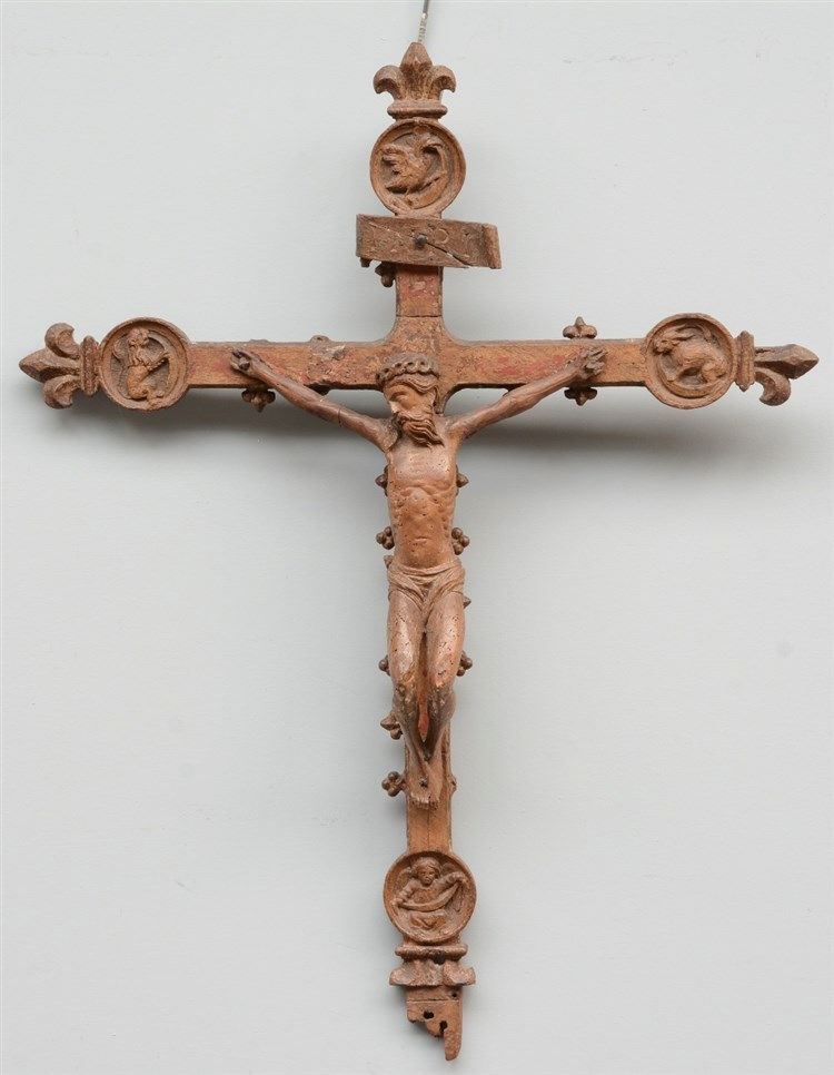 A 16thC oak crucifix, the cross decorated with animals from the Bestiary, t
