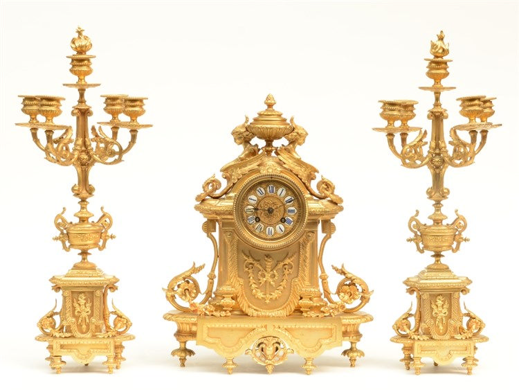 An imposing Neoclassical gilt bronze garniture, last quarter 19thC, the dia