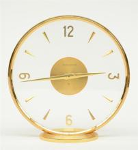 A circular gilt brass Jaeger - Lecoultre mantel clock, H 16,5 - Diameter 16