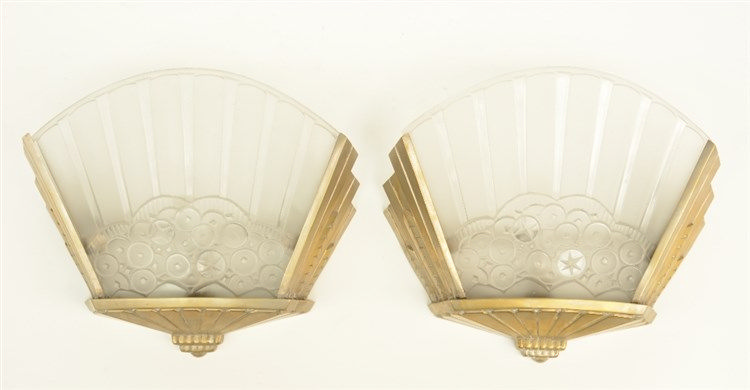 Two brass, chrome plated Art Deco wall lights, the light shades in cast and