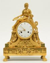 A second quarter of the 19thC ormolu bronze mantel clock said 'à sujèt', de