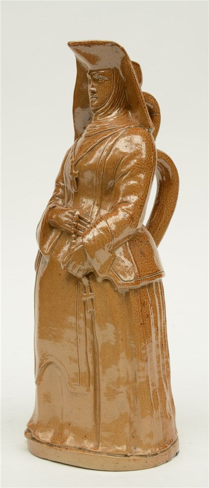A French brown glazed stoneware cider jar, modeled as a nun, H 37 cm (minor