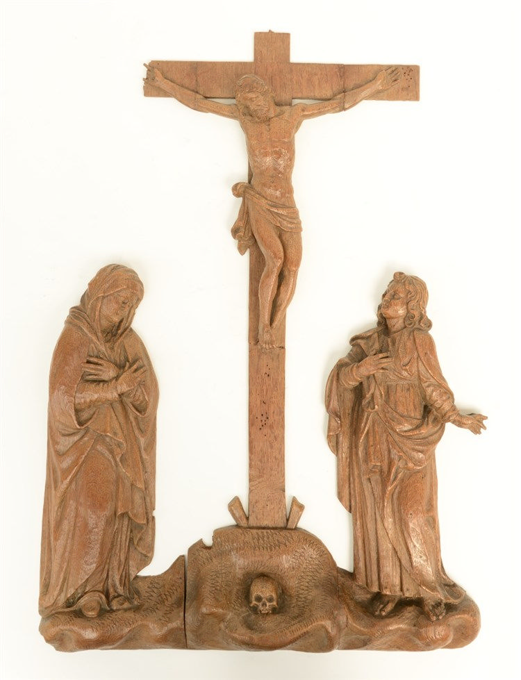 An 18thC oak Low Countries three part Golgotha group, H 58 - W 41,5 cm (res