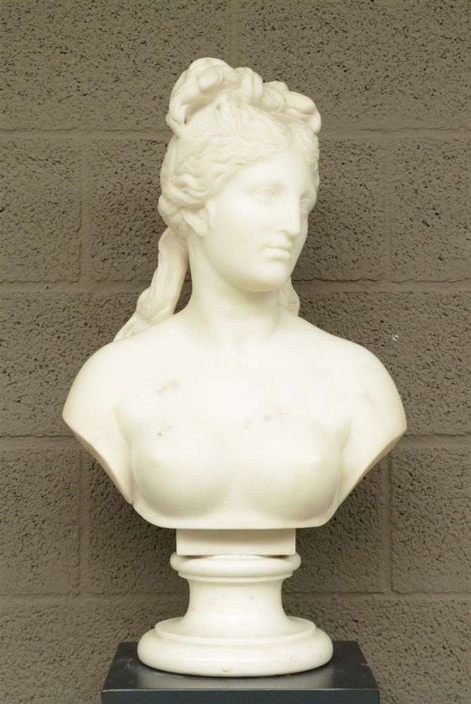 A non signed womans bust, on a matching base, Carrara marble, H 70,5 cm