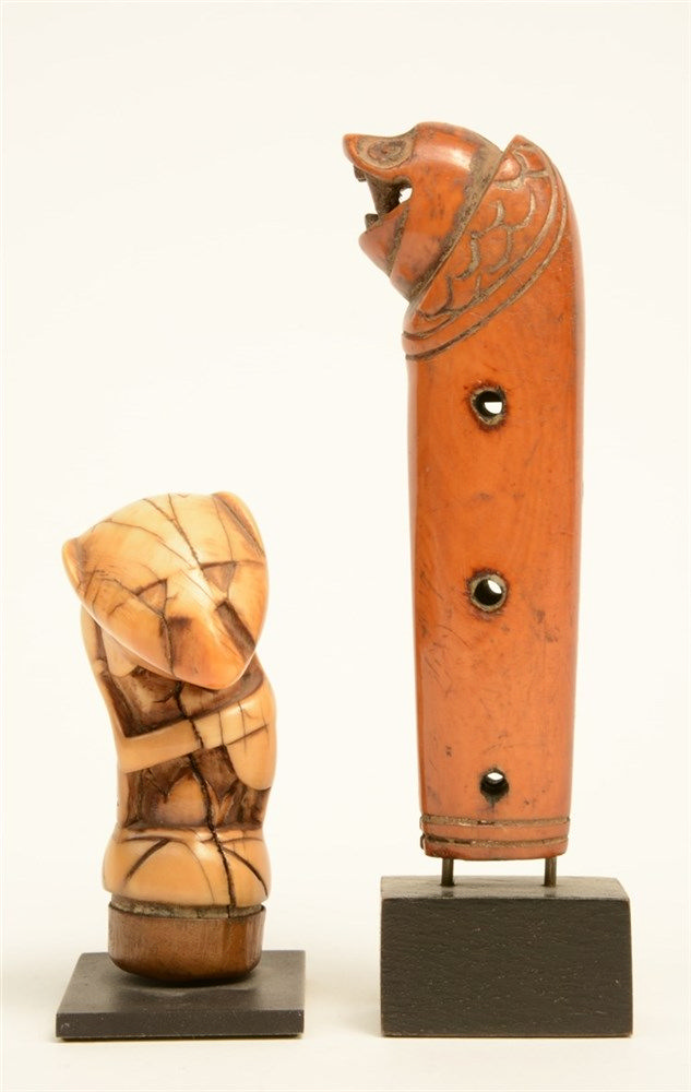 An ethnographical mammoth-ivory knife grip; added a ditto oppossum, both on