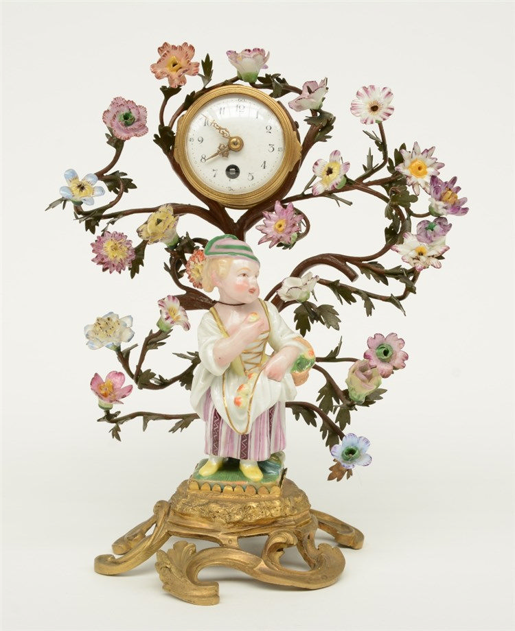 A charming Rococo style mantelclock in the Berlin manner, the bronze mounts