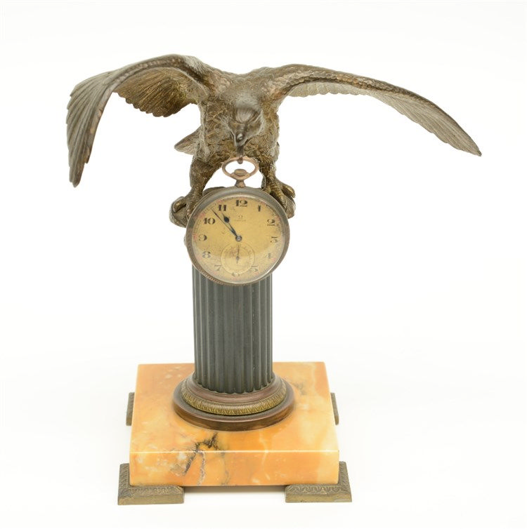 A late 19thC Neoclassical gilt bronze watch stand on a yellow Siena marble