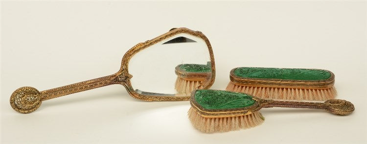 A three-piece toilet set, with gilt red copper filigree mounts and green mo