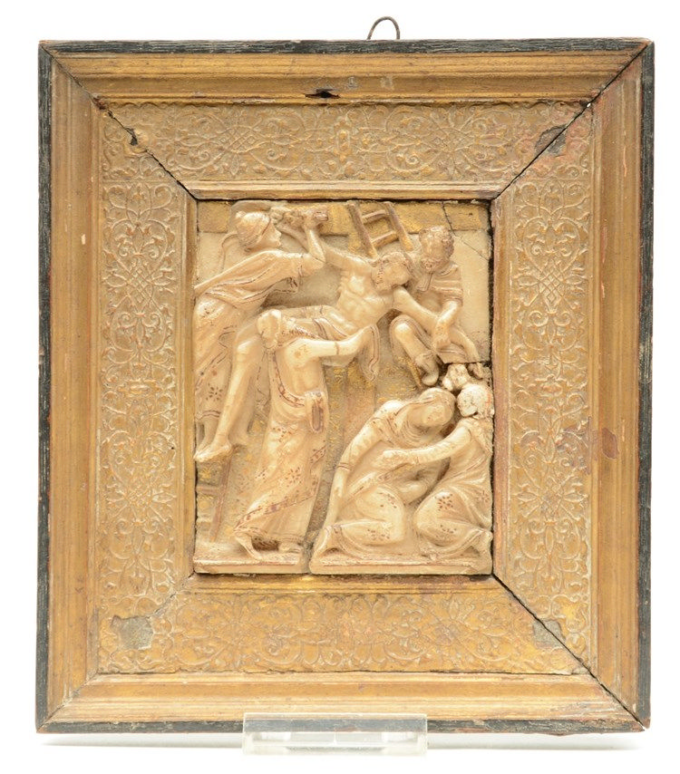 A 17thC partly gilt Malines alabaster sculpture depicting the descent from