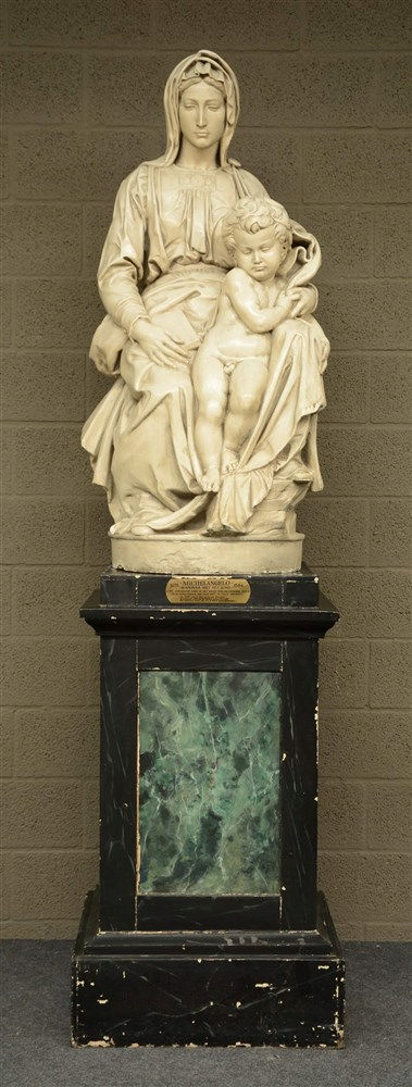 A patinated gypse sculpture, depicting Michelangelo's Madonna with Child, o