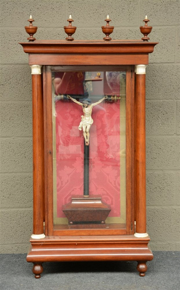 A first half of the19thC mahogany display cabinet, inside a crucifix with a