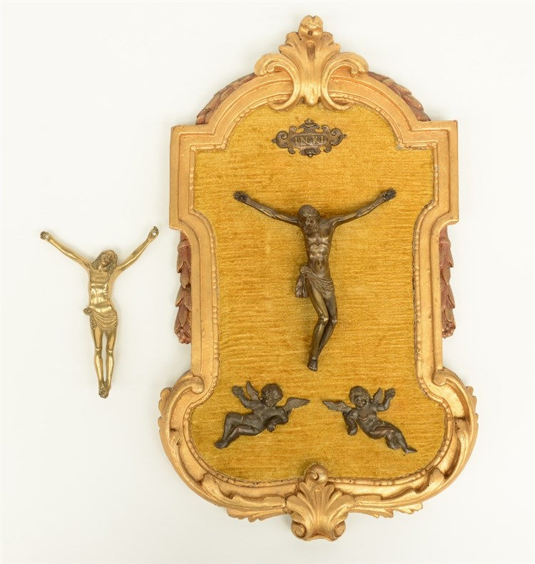 A 16thC bronze Corpus Christi mounted in an 18thC gilt wooden frame; added