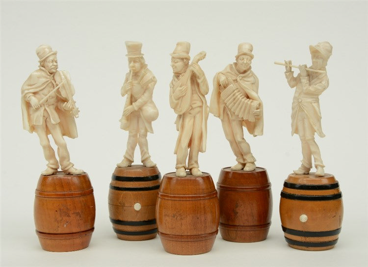 Five fine carved ivory street musicians, on a matching barrel shaped wooden