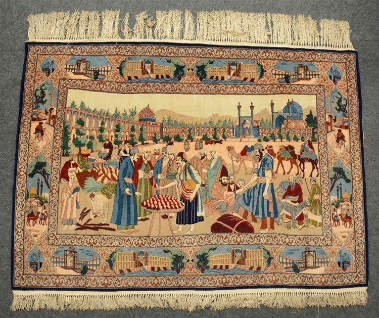 A rare Oriental rug, decorated with a market scene and various town views,