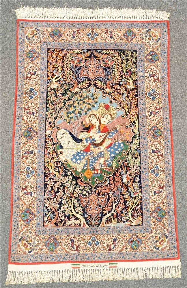 An oriental rug decorated with a genre scene, floral motifs and birds, 'Isp