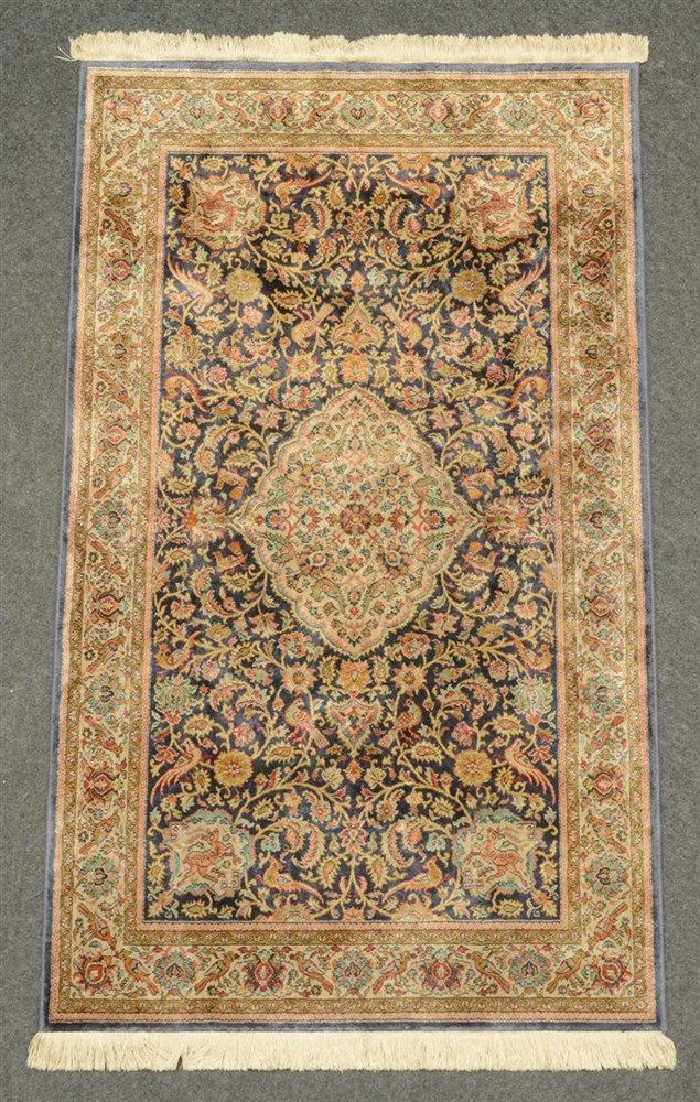 An Oriental rug decorated with animals and floral motifs, silk on cotton, 1