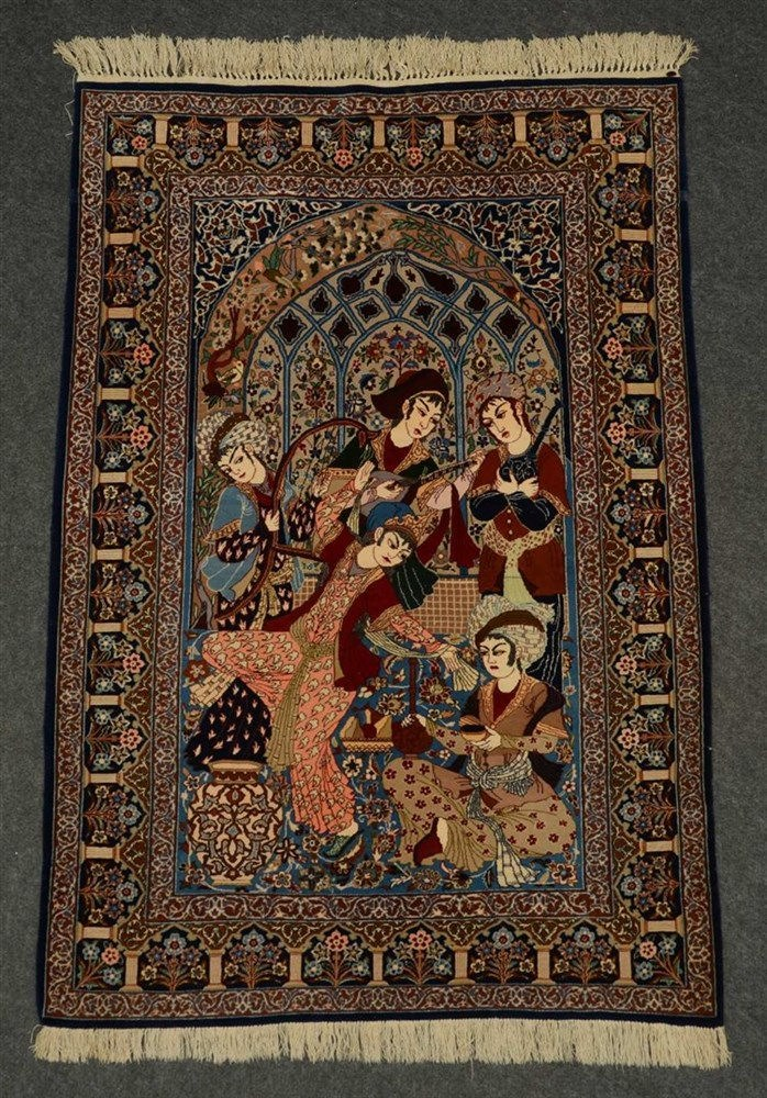 An Oriental rug decorated with an animated scene and floral motifs, 'Ispaha