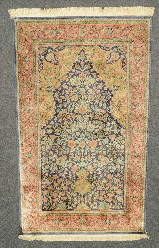 An Oriental rug depicting the Tree of Life, silk on cotton, 102,5 x 173 cm