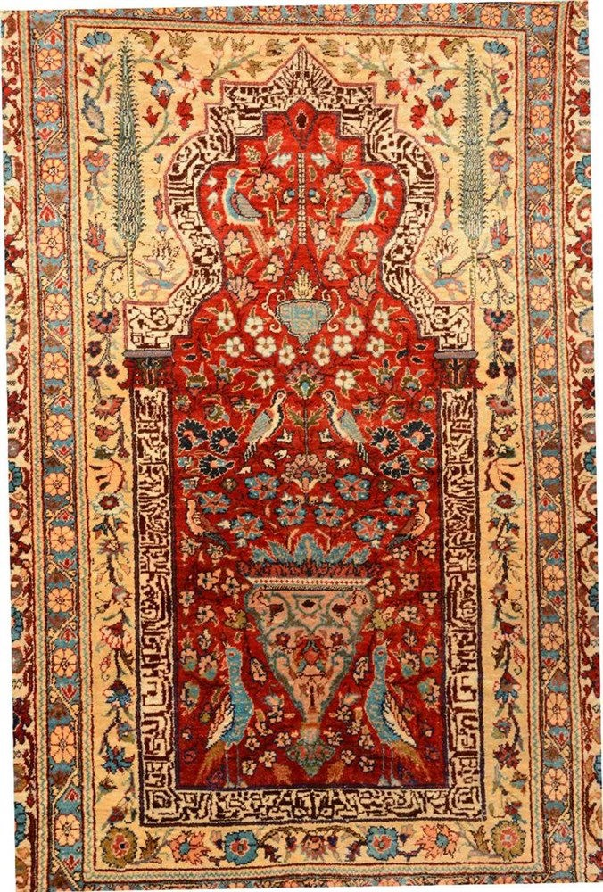 An Oriental silk and cotton carpet, 92 x 140cm