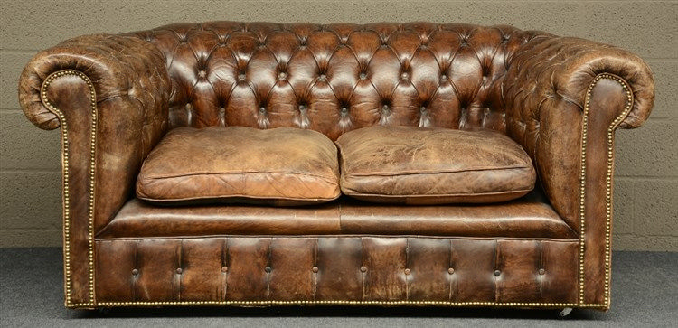 A Chesterfield sofa with brown leather upholstering,  H 77 - W 177 - D 96 c