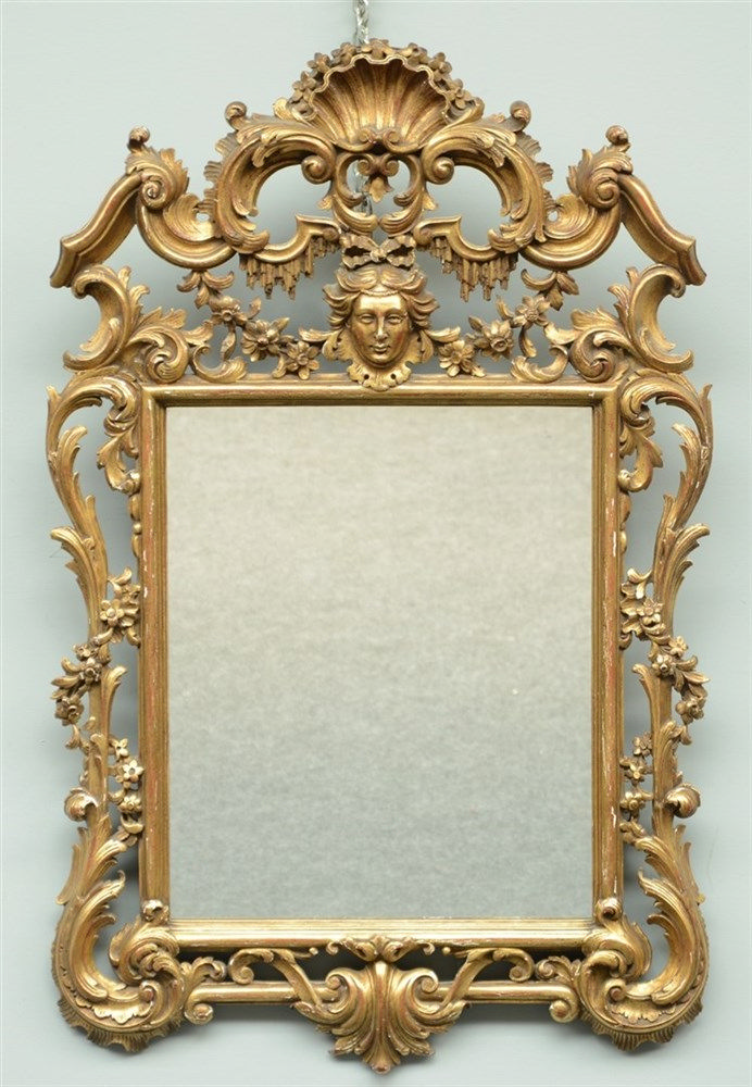 Richly carved gilt wooden early Rococo style mirror, H 99,5 - W 64 cm
