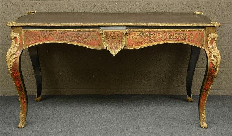 A 19thC Régence style boullework bureau plat on cabriole legs with gilt bro