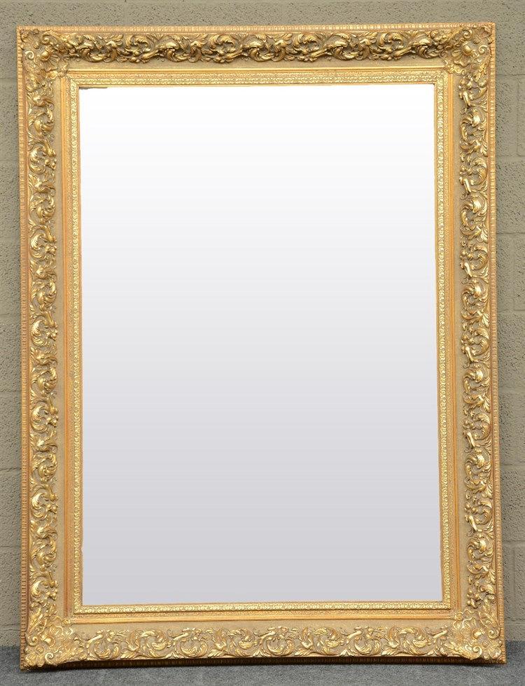 A gilt mirror,H 160,5 - W 120,5 cm