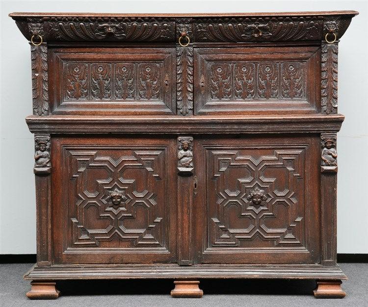 A 17thC renaissance style Flemish oak cupboard, H 139,5 - W 164 - D 67cm