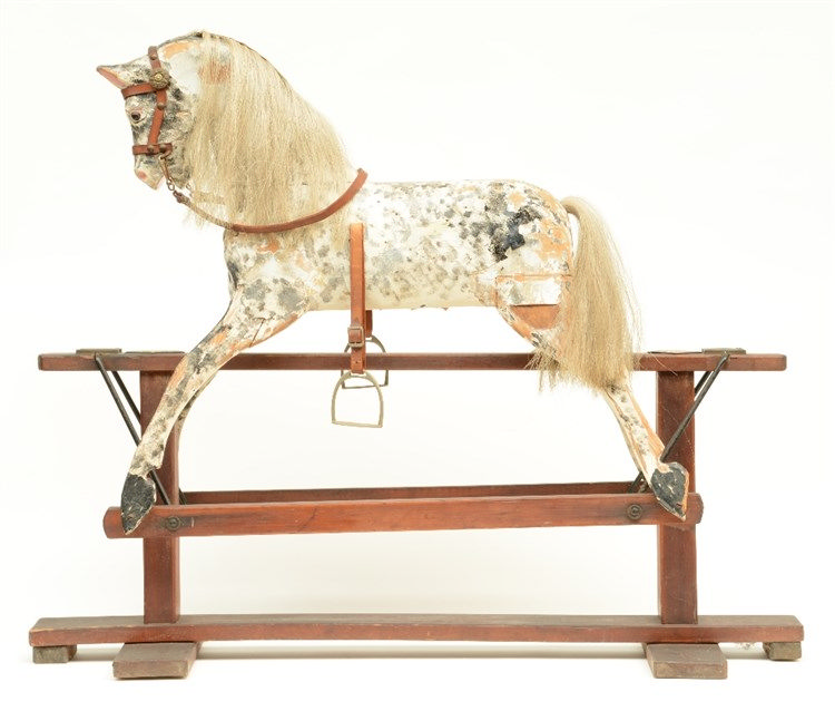 A 19thC polychrome painted wooden rocking horse, H 87 - W 106,5 - D 35 cm
