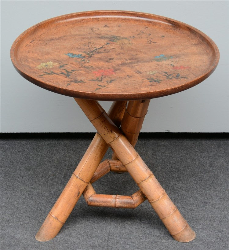 A last quarter of the 19thC occasional table with a bamboo woven tripod an