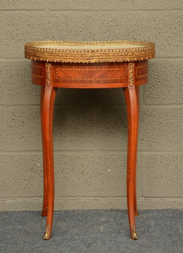 A Neoclassical occasional table, mahogany veneered, with marble top and bro