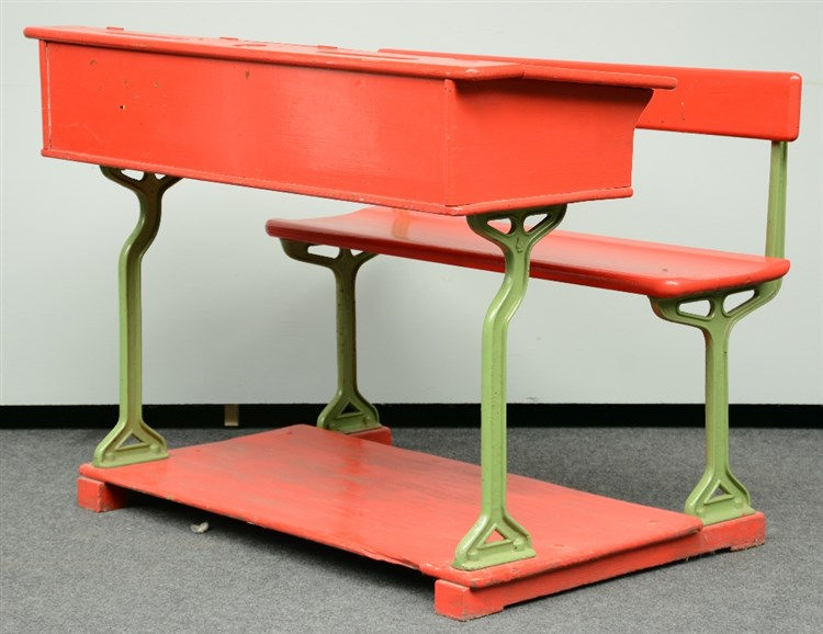 A red lacquered pitchpine and cast iron school desk, H 90 - W 120,5 - D 85,