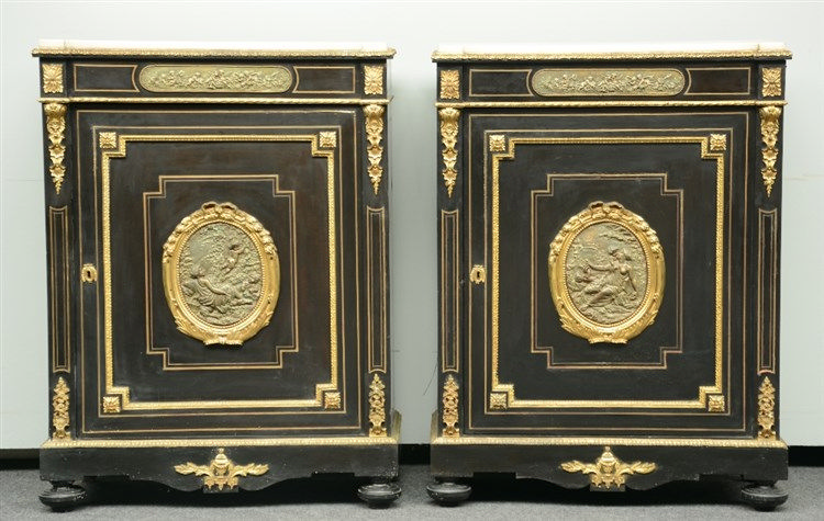 A pair of Neoclassical ebonized cabinets, with gilt bronze mounts, the roun