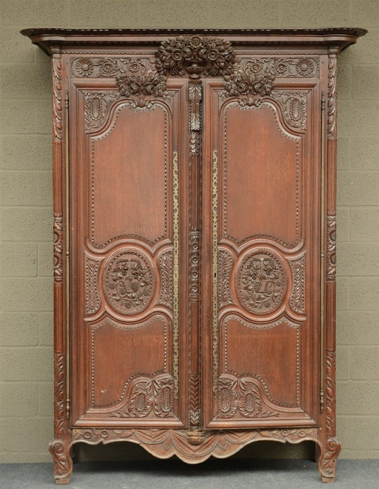 An early 19thC richly carved oak armoire, H 237 - W 180 - D 63 cm