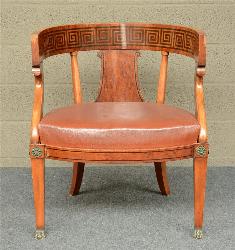 A Neoclassical mahogany armchair, with bronze mounts, H 79,5 - W 69 - D 64