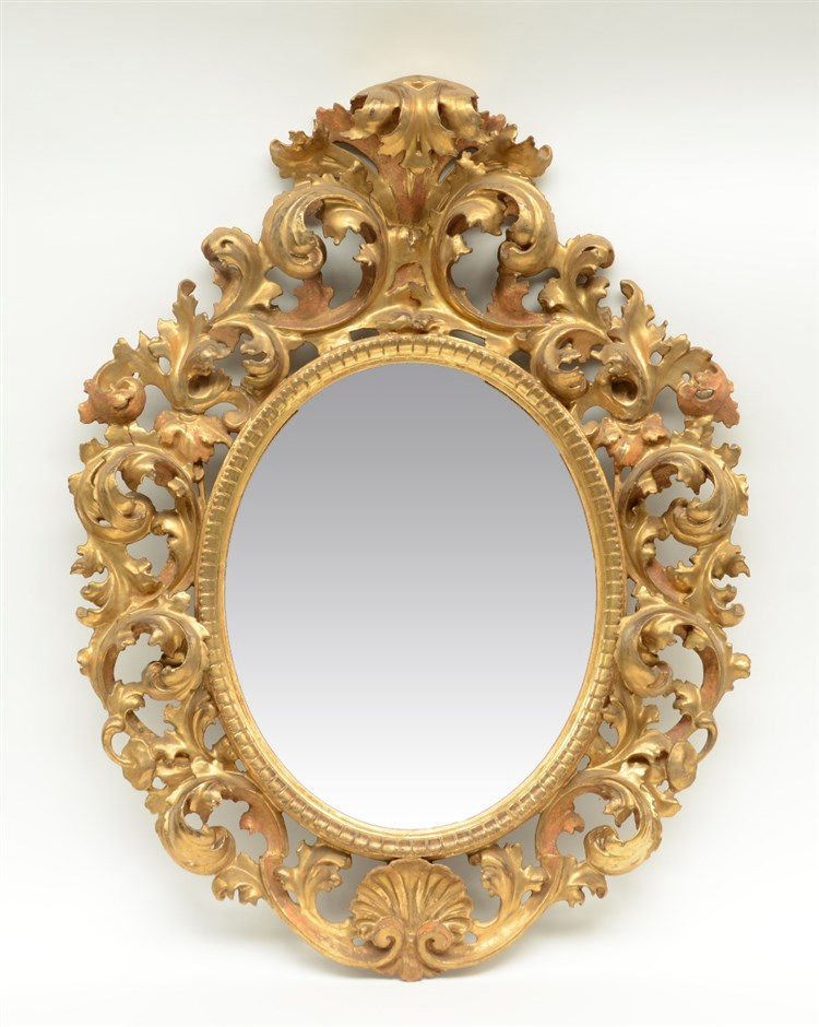 An Italian baroque style carved and giltwood mirror, 19thC