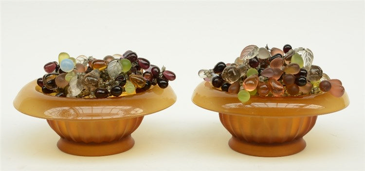 A pair of colored glass bowls decorated with ditto fruit bunches, mountable