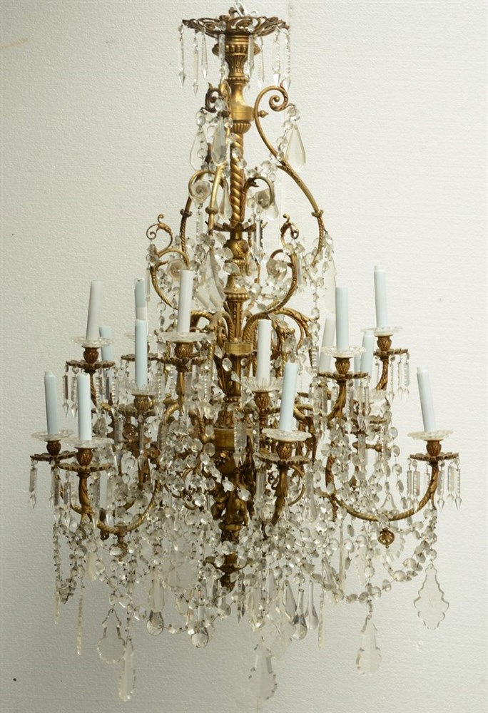 An impressive gilt bronze and crystal crown chandelier, the lower central p
