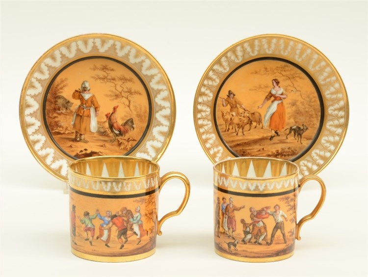 A rare pair of polychrome decorated Biedermeier period cups and saucers, ab