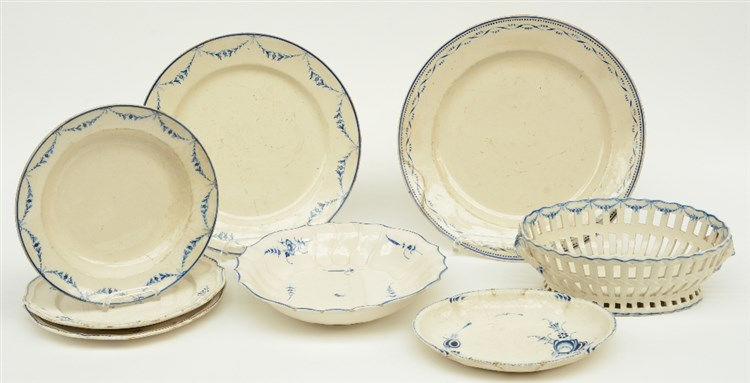 A blue decorated creamware bread basket and two similar raviers; added two