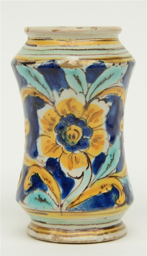 An 18thC Italian polychrome decorated albarello, H 14,5 cm (rimchip on the