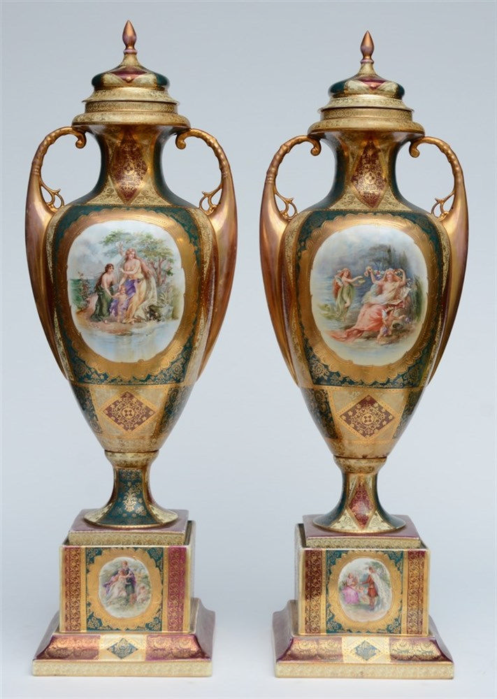 A pair of polychrome and gilt Vienna vases and covers on matching bases, la