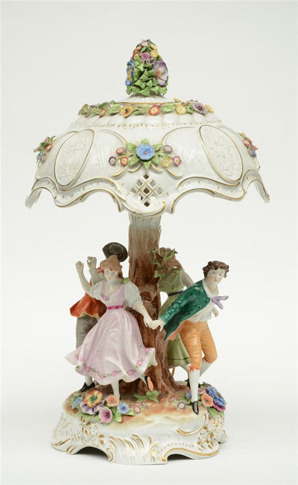 A German polychrome decorated porcelain table lamp,  the central part set w