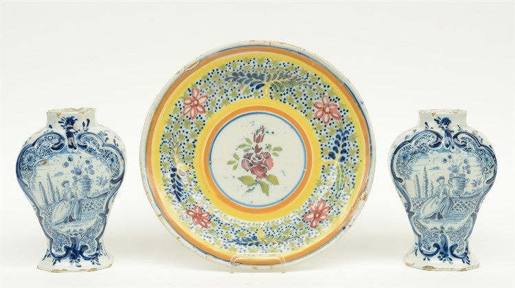 A 19thC polychrome decorated Flemish earthenware plate; added two blue and