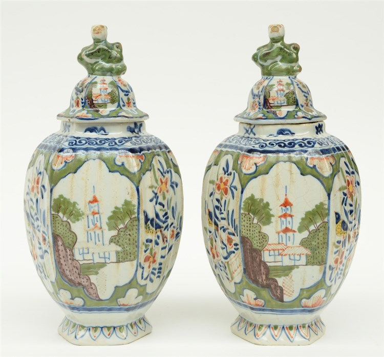 A pair of polychrome decorated Dutch Delftware jars and covers, maked with