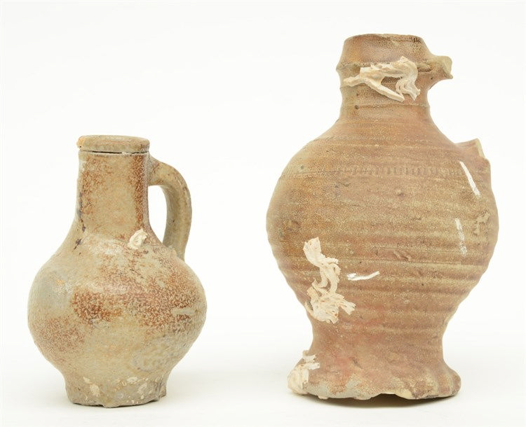 Two 15th and 16thC stoneware jugs, H 12,5 - 17 cm (one with thegrip missing