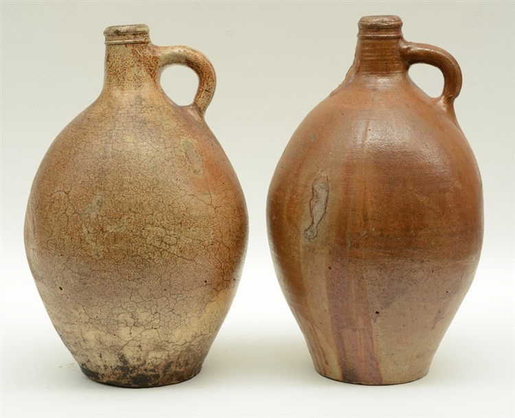 A 17thC brown glazed stoneware bellarmine jug; added an 18thC brown glazed