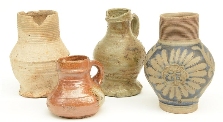 Four Rhineland stoneware jugs, 15th - 16th - 17thC, H 9,5 - 16,5 cm (damage