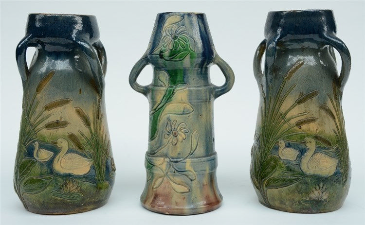 Three Art Nouveau style typical Flemish earthenware vases: one marked L.M.D